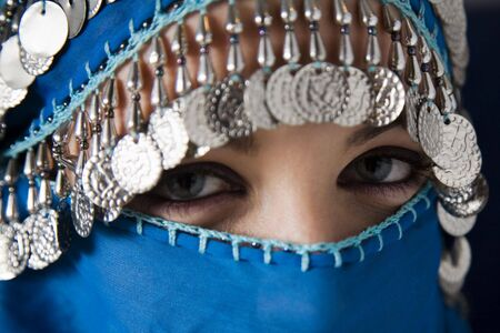 middle eastern culture: belly dancer with traditional veil photo