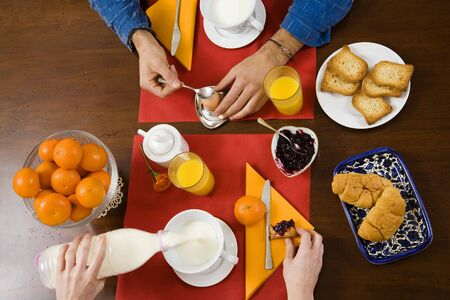 healthy living: young couple having breakfast at home photo