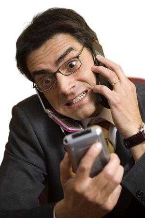 empresario enojado: hombre de negocios enojado que grita en el tel�fono Foto de archivo