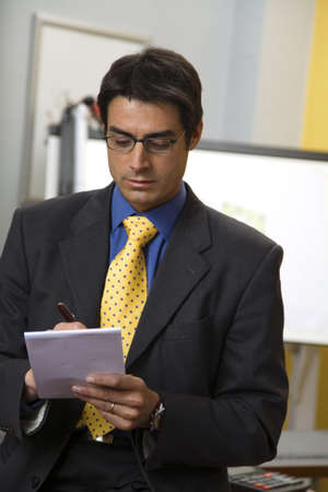 work place: successful businessman taking some notes Stock Photo - 871034