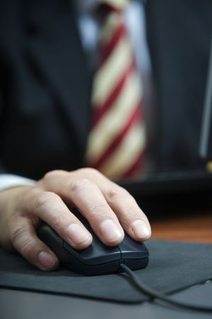 laborious: people at work: close-up of a businessman using a mouse