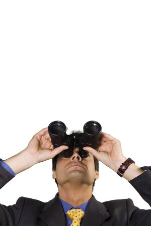 successfulness: business vision: businessman looking up though binoculars Stock Photo