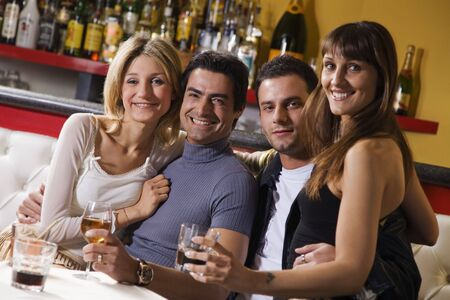 people partying: healthy living: friends at a restaurant having fun together Stock Photo