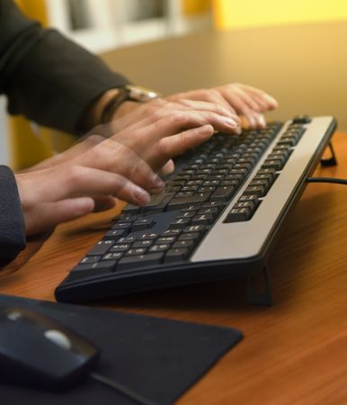 strenuous: people at work: motivated businessman typing fast