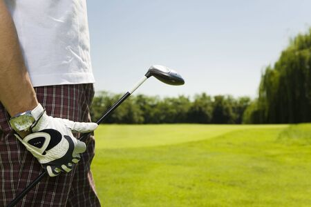 Golf club: golfer moving to the next hole   photo