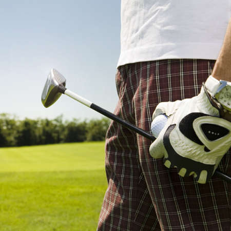 passtime: Golf club: golfer moving to the next hole   Stock Photo