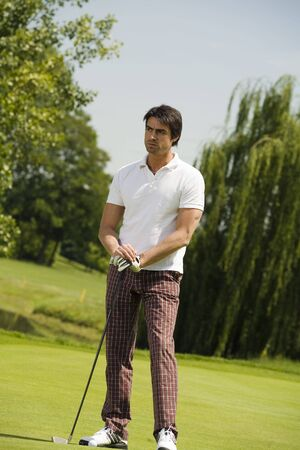 passtime: Golf club: golfer concentrating on the next shot  Stock Photo