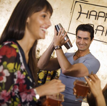 girls night out: girls night out: girls flirting with the barman  Stock Photo