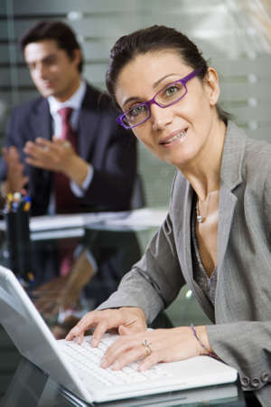successfulness: People at work: businesswoman working with laptop during a meeting