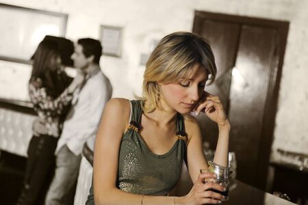 bore: girls night out: girl alone in a pub  Stock Photo