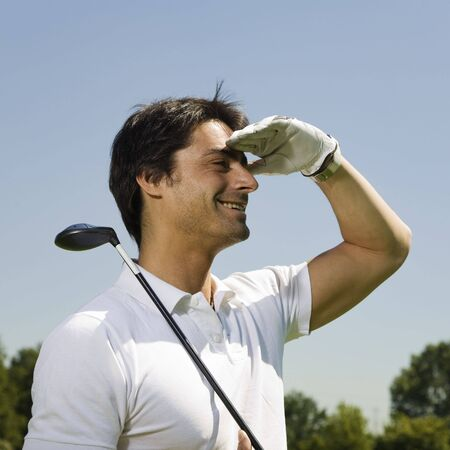 searching for: Golf club: golfer searching for the ball  Stock Photo