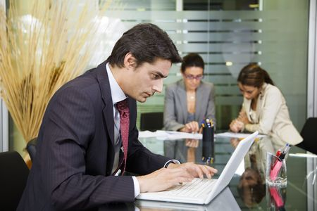 woman hard working: People at work: businessman working with laptop during a meeting