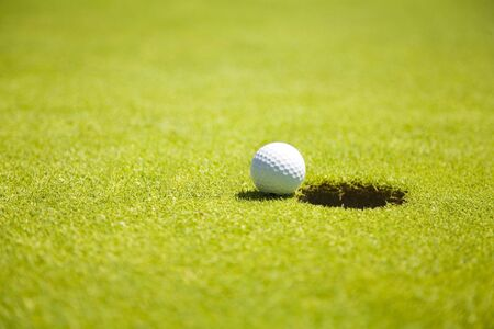 passtime: Golf club: ball close to the 18th hole   Stock Photo