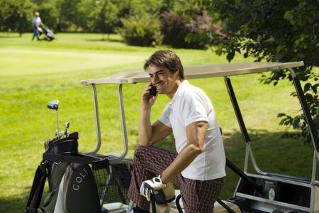golf cart: Golf club: golfer concentrating on the 18th hole