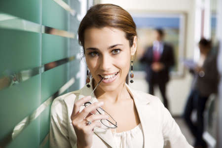 committed: Office life: young business woman looking at the camera smiling
