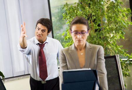 disharmony: Office life: business team having a fight