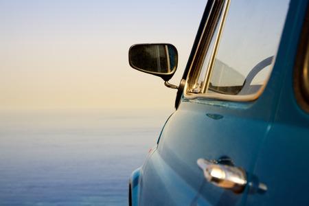 fiat: travel destination: vintage car parked near the sea  Stock Photo