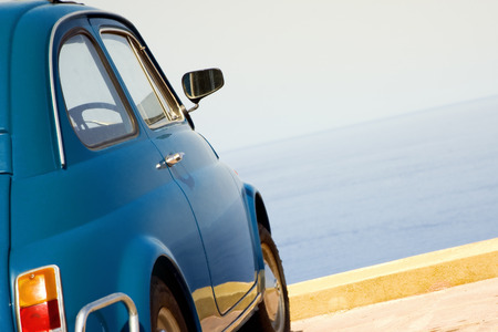 endlessness: travel destination: vintage car parked near the sea  Stock Photo