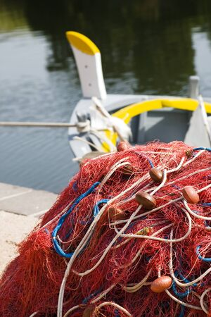 commerce and industry: red fishing nets and boats   photo