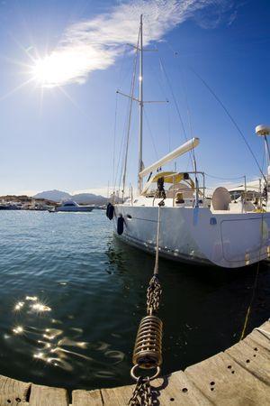 lavishly: sail boat anchored in a port in Sardinia Stock Photo