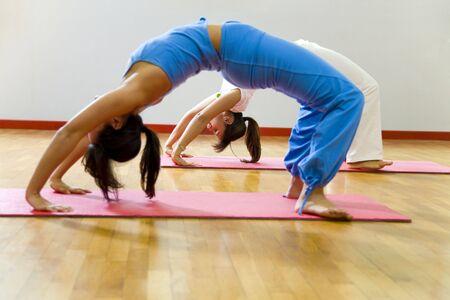 health club: women doing stretching and aerobics photo