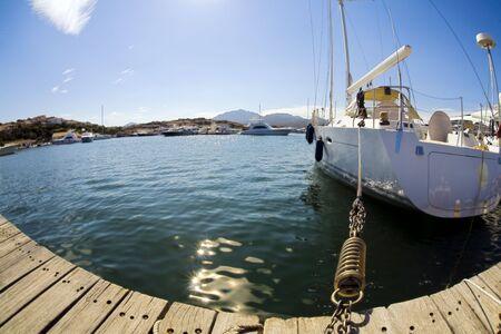seacoast: sail boat anchored in a port in Sardinia