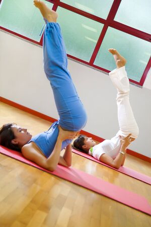 health club: health club: women doing stretching and aerobics