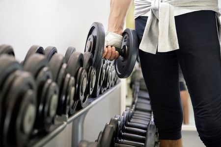 health club: health club: guy in a gym doing weight lifting
