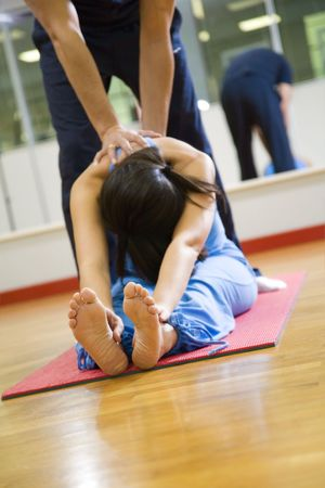 contortionist: health club: women doing stretching and aerobics