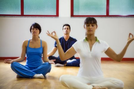 health club: health club: man and women doing yoga