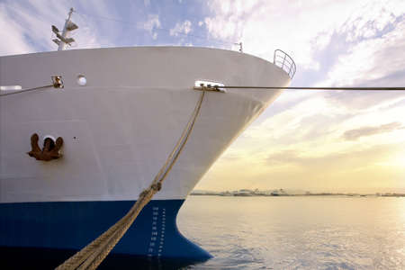 industry and commerce: cargo ship anchored in a harbor