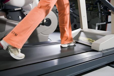 health club: woman running on a tapis roulant Archivio Fotografico