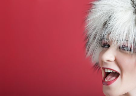 positiveness: winter scene: young girl in fur on a red background  Stock Photo