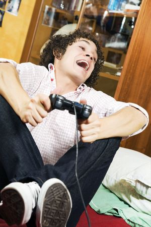 videogame: playing video games: guy feet crossed on the bed having fun with his brand new videogame