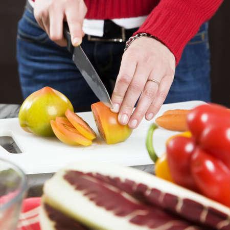 food stuff: home life: woman preparing something to eat Stock Photo
