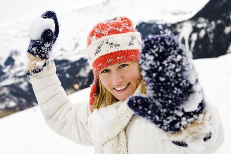 women fight: winter scene: girl playing with snowballs