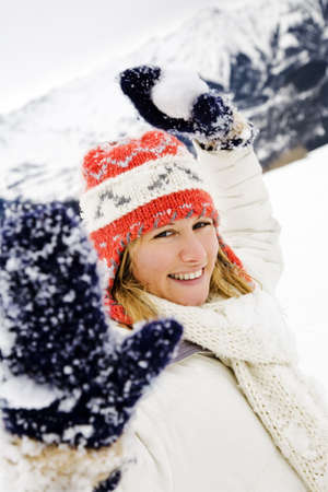 winter scene: girl playing with snowballs photo