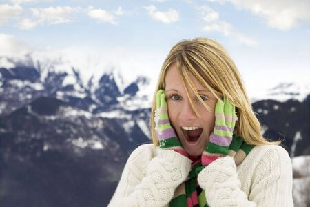 winter scene: astonished woman with hands on cheeks photo