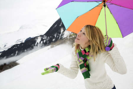 winter scene: girl checking out if its snowing. Copy space photo