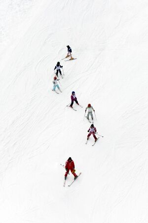 educating: winter scene: kids learning to ski and their instructor