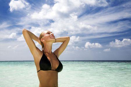 tropical beach: perfect girl meditating on a tropical beach. Copy space Stock Photo