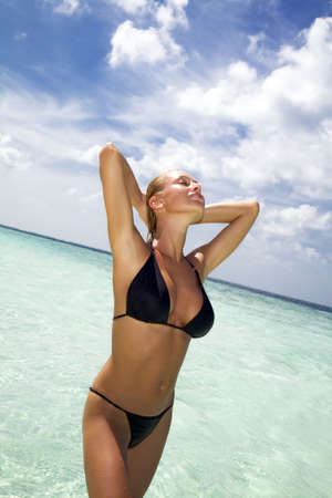 tropical beach: perfect girl meditating on a tropical beach. Copy space photo