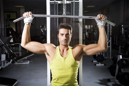 health club: health club: man in a gym doing weight lifting