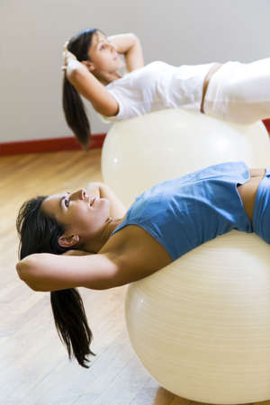 health club: health club: woman doing stretching and aerobics