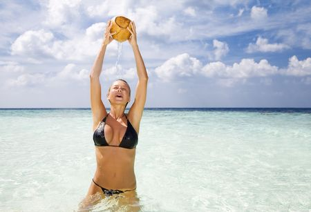 tropical beach: woman relaxing on a tropical beach. Copy space photo