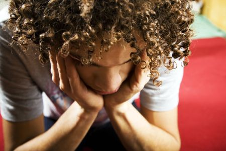 social issues: depressed guy with hands on temples Stock Photo - 2561488