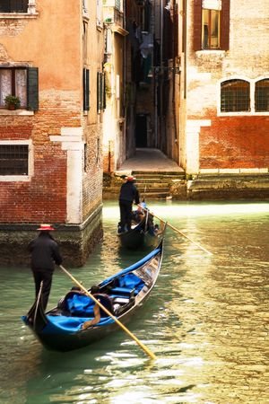 tourist attractions: Venice at the sunset. The focus is on the left wall while Gondolas are slightly blurred Stock Photo - 2583613