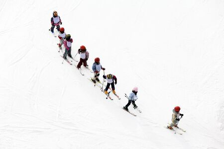 winter scene: kids learning to ski. No faces are recognizable
