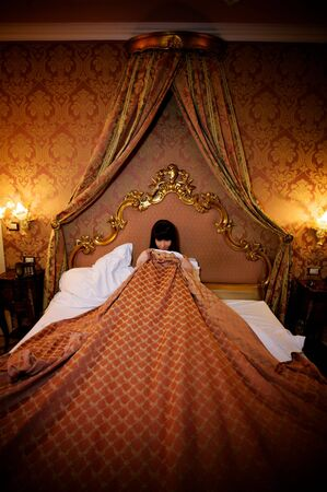 embarrassment: shamed girl in bed covering herself