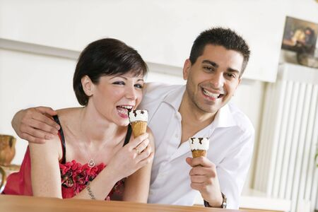 domestic life: happy couple eating an ice cream photo